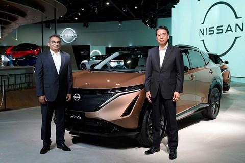 Ashwani Gupta (left) alongside the Nissan Ariya
