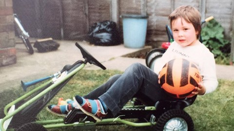Once Keith outgrew his trike, four wheels proved better; football is a red - well, orange - herring