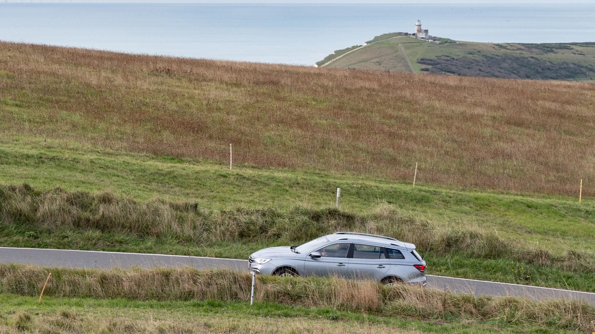 Grey MG5 EV estate side elevation driving in distance
