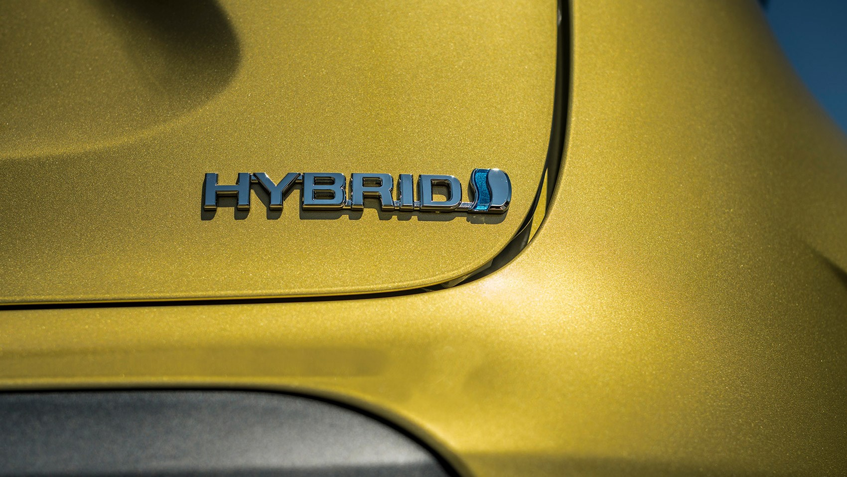 yaris cross hybrid badge