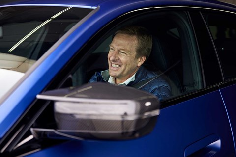 BMW CEO Oliver Zipse in the new i4 electric saloon