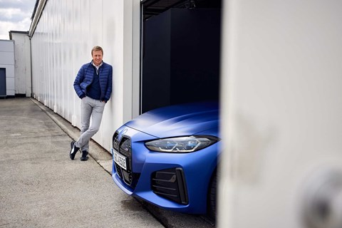 BMW CEO Oliver Zipse with the i4 electric car