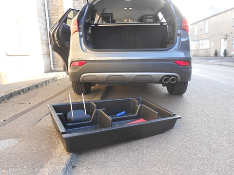 The removable under-floor storage cubby removes from Santa Fe's boot, making it deeper