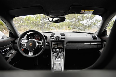 Inside the Porsche Cayman GTS cabin. Sensible, sober, seductive