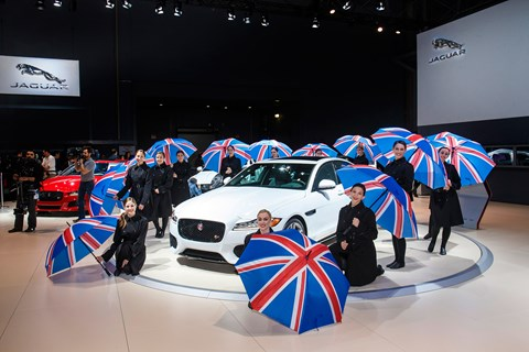 Brits ahoy! Union Flag-toting umbrellas ward off rain at Jaguar XF world debut