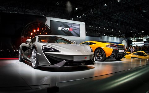 A pair of McLaren 570S supercars on the stand in New York