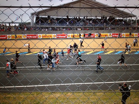 Fans invade the track after Porsche win