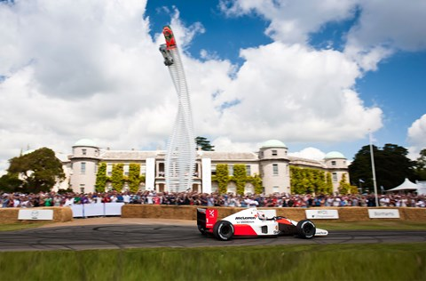 Jenson Button drives McLaren MP4-6 past Goodwood House