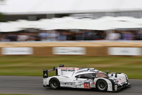 Brendon Hartley blasts up the Goodowood hill in the Le Mans-winning Porsche 919 hybrid