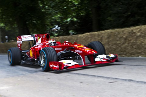 Kimi Raikkonen took his 2010 Ferrari grand prix car, the F10, up the hill