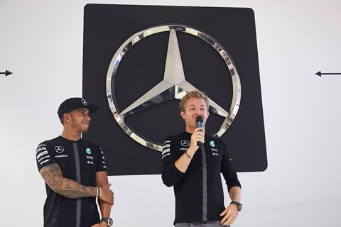 The Mercedes-Benz star looms large behind Nico and Lewis at Silverstone 2015