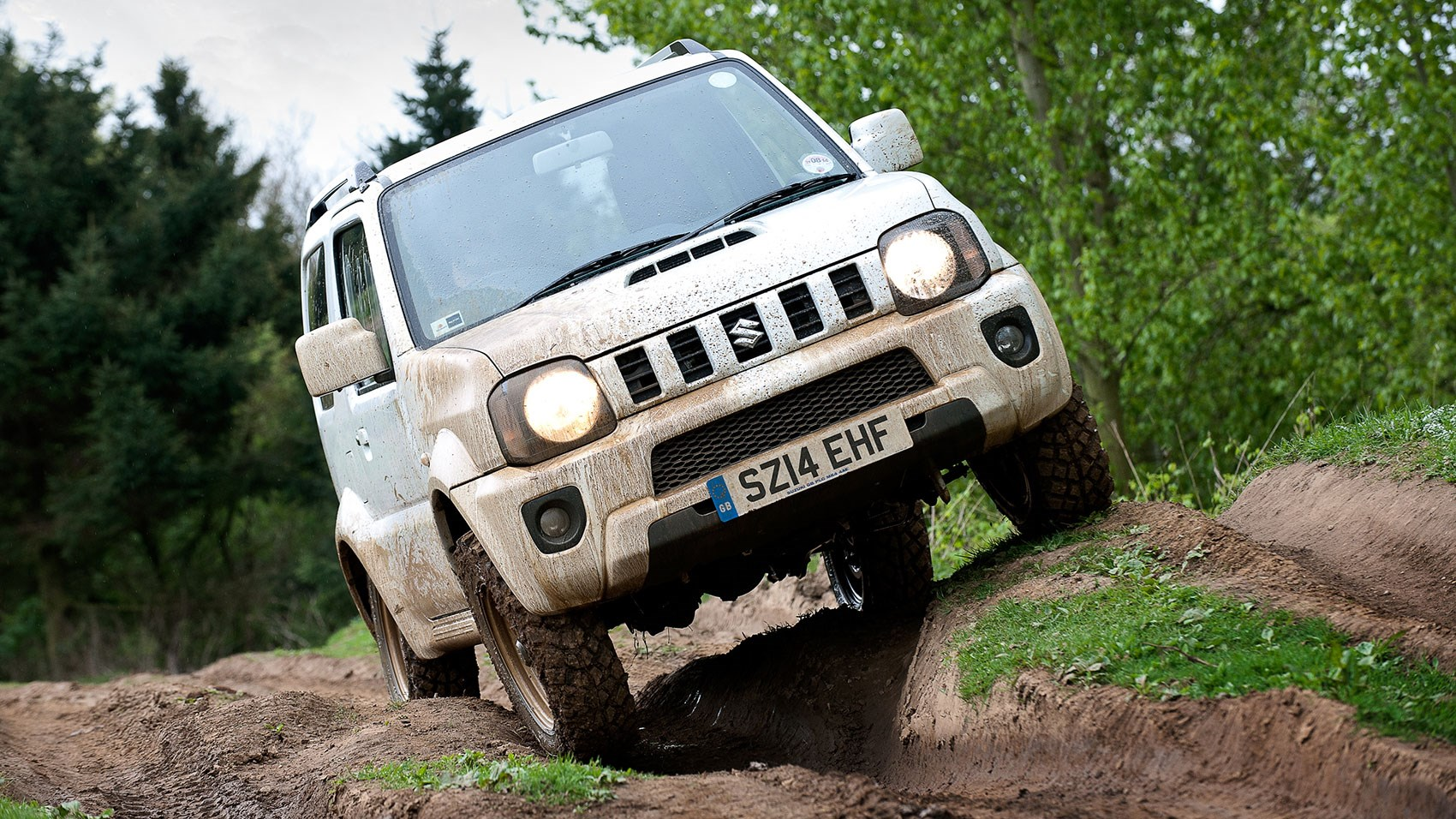 ... Suzuki Jimny interior Extreme approach and departure angles help the  Jimny off-road ...