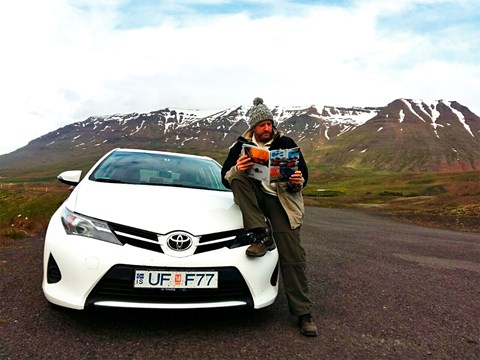 Pepe takes a moment in the Icelandic landscape to catch up on the previous month's issue of CAR
