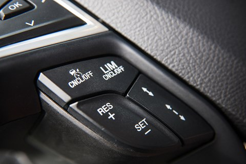 Activated through steering wheel-mounted buttons , the engine management system limits the supply of fuel
