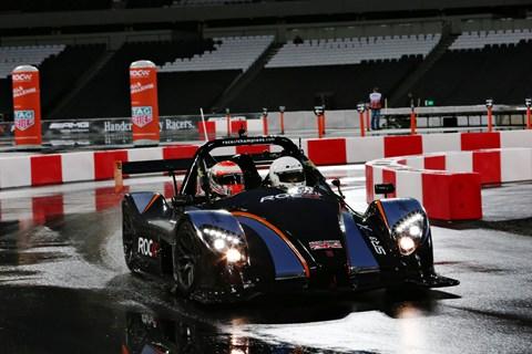 McLaren F1 driver Jenson Button practising in the Radical SR3 RSX