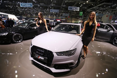 Girls adorn a tuner car at the Geneva motor show