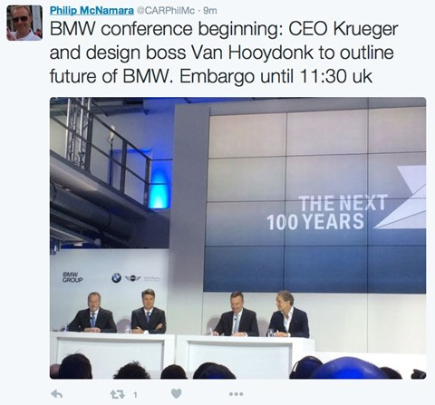 Top brass at BMW settle down for the press conference