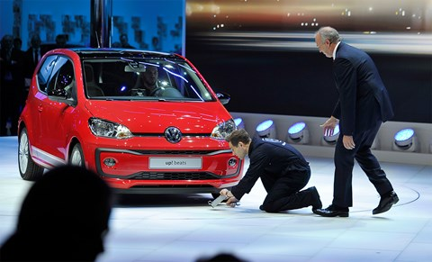 VW's Stackmann mislays his sense of humour as comic Simon Brodkin fits a 'cheat box' to the Up at Geneva