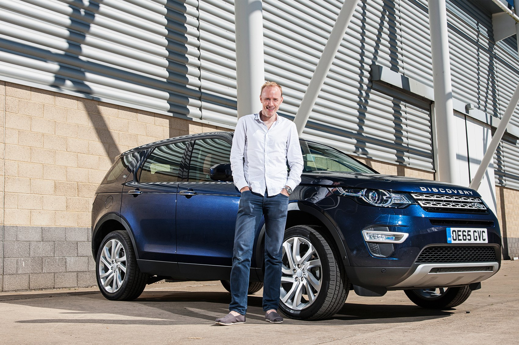 CAR's editor-in-chief Phil McNamara with the Land Rover Discovery Sport ...