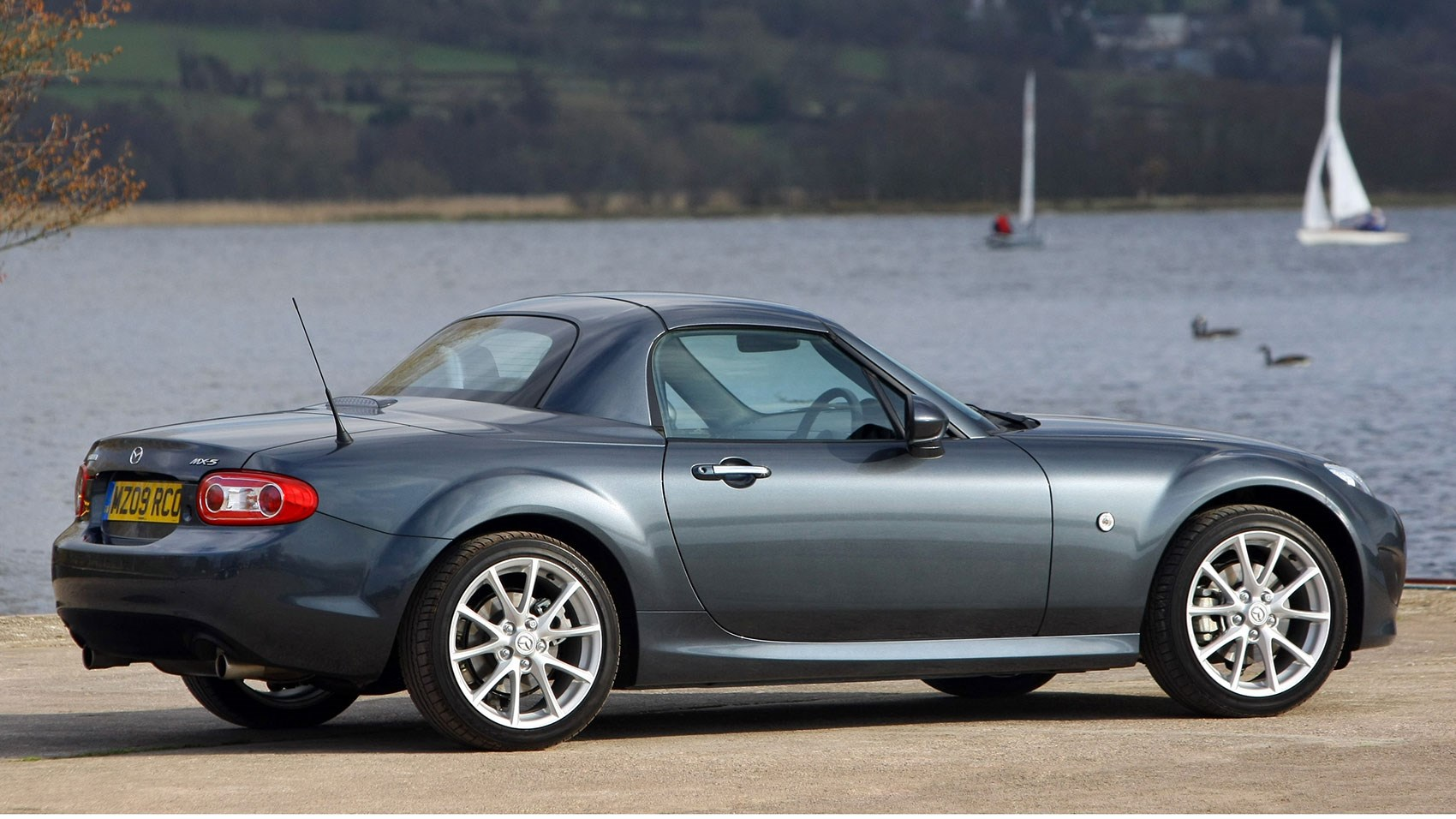 2005 roadster coupe gave the mx 5 a motorised folding hardtop