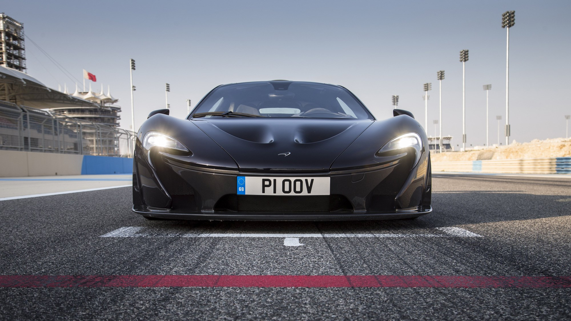 McLaren P1 review, Bahrain, black, dead-on front view