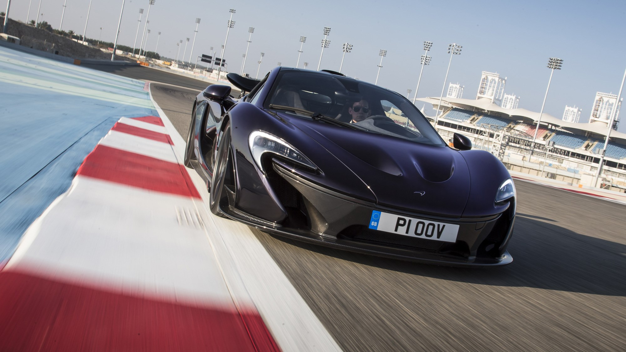 McLaren P1 review, Bahrain, black, front view, driving on circuit