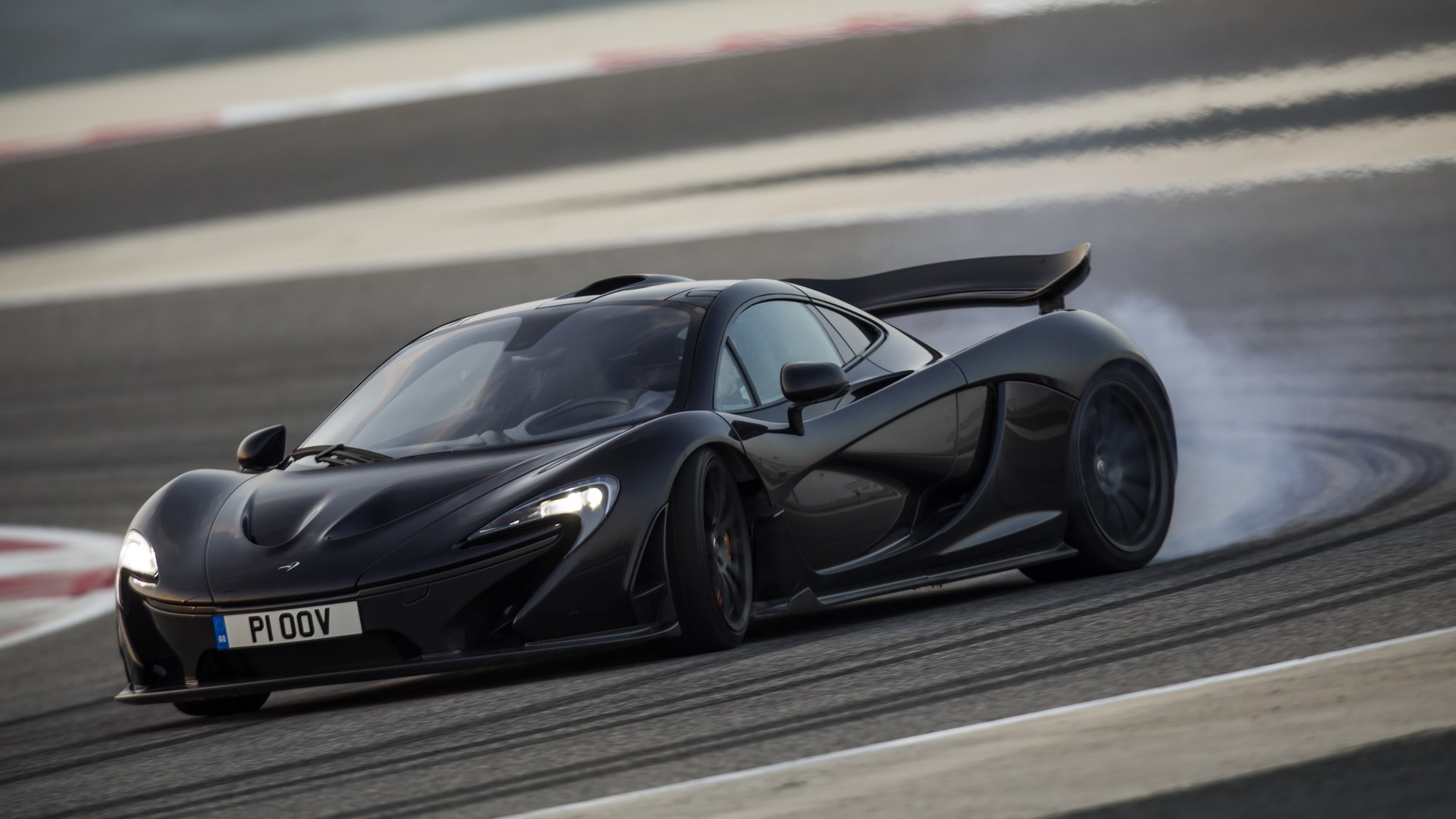 McLaren P1 review, Bahrain, black, front view, oversteer, tyres smoking
