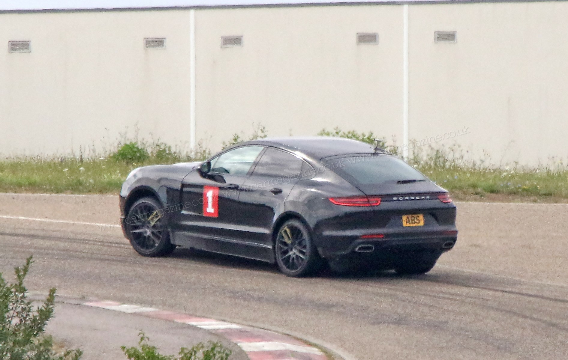Porsche Cayenne Coupe sporty SUV spotted winter testing