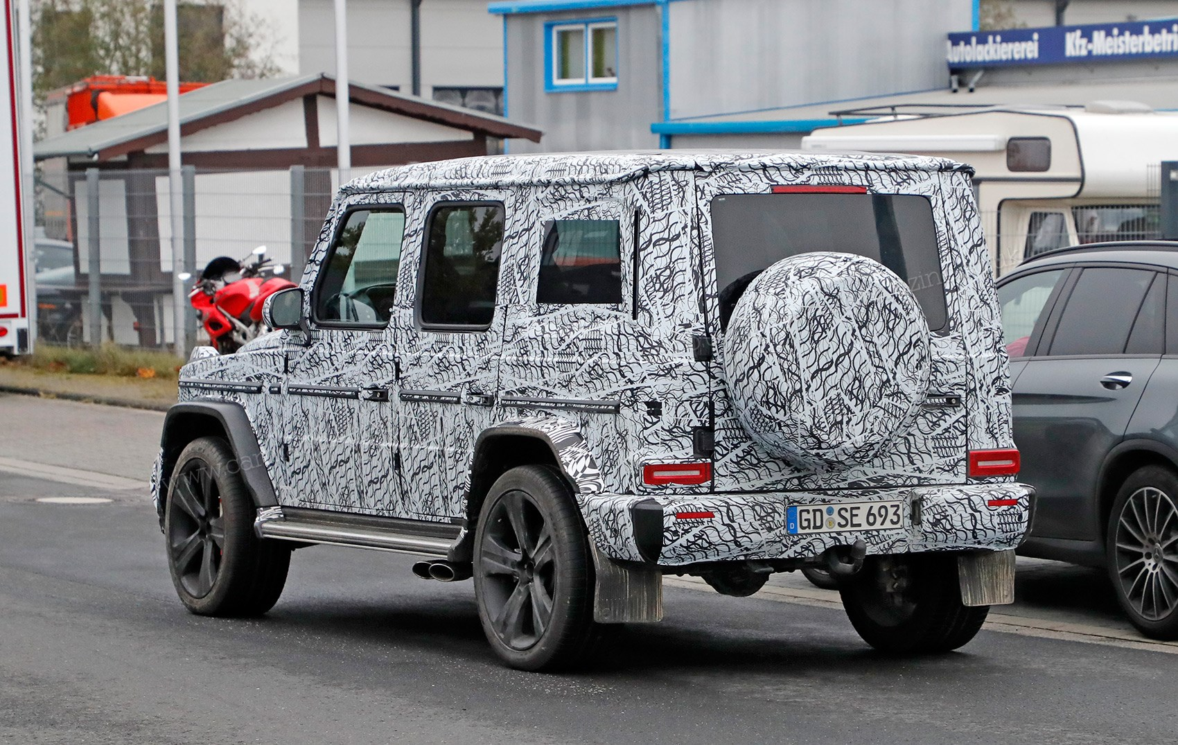 New 2018 mercedes g class spied by car magazine for Mercedes benz baby g class