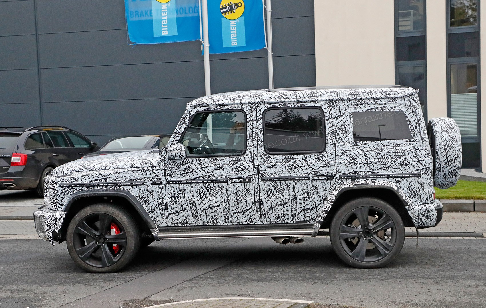 New 2018 mercedes g class spied by car magazine for Mercedes benz g class amg