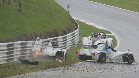 Sam Moores, Peter Brookes and Richard Baxter after the attempted restart at Cadwell Park