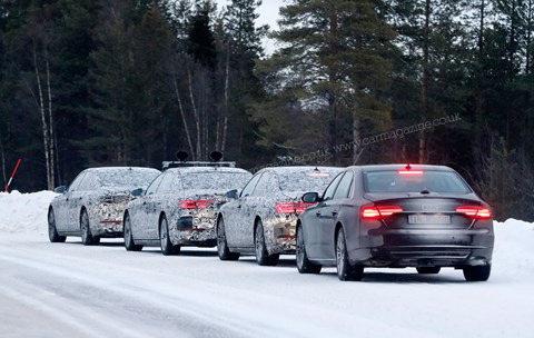 A procession of Audi A8s in winter testing in Sweden