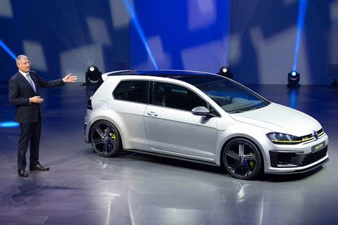 The concept VW Golf R400 and board member Heinz-Jakob Neusser, who confirmed the project's green light to CAR magazine