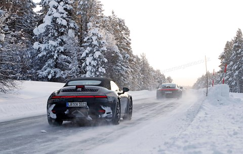 A pair of new '992' Porsche 911s winter testing in Sweden
