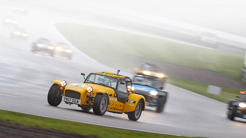 Close racing at Rockingham in the wet during the Caterham Academy