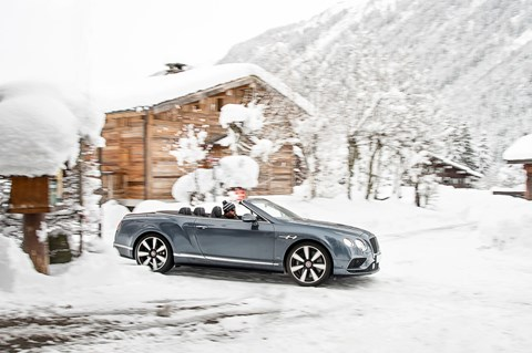 Bentley Continental GT Convertible side tracking snow
