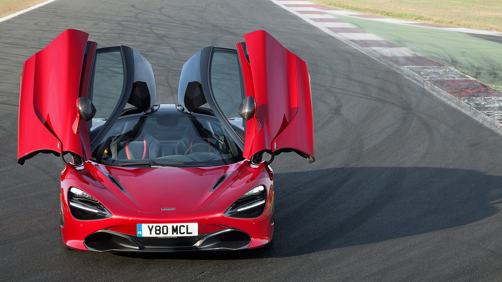 McLaren 720S Memphis Red front doors open