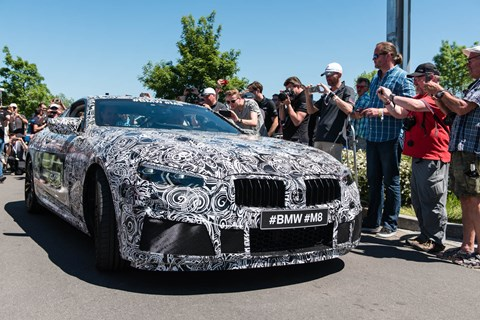 BMW's M Division gave the world a preview of its upcoming M8 luxury performance car, as a camouflaged prototype completed a demo lap of the circuit before the start of the 24h race