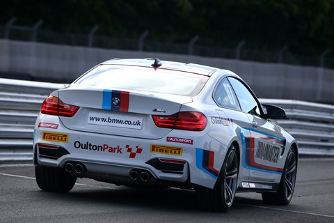 BMW M4 racing driver experience rear quarter