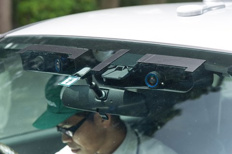 Sensors festoon the windshield of this prototype driverless Honda