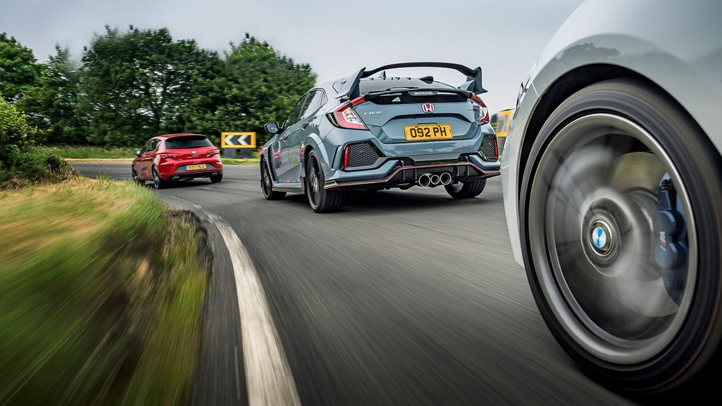Giddily-styled Civic Type R and undercover Cupra both fly the flag for old-school front-drive virtues
