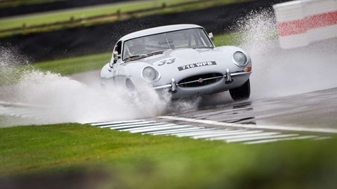 Jaguar E-type splashes through puddle at 2017 Goodwood Revival