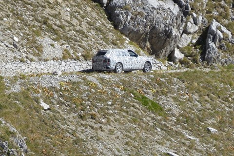 Rolls-Royce Cullinan negotiates a dusty track high in the Italian mountains