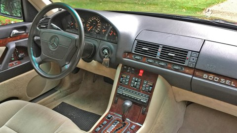 Inside the W140: 'glossy timber still adorns the cabin, and the wheel's larger than what you'd expect to find on a yacht'