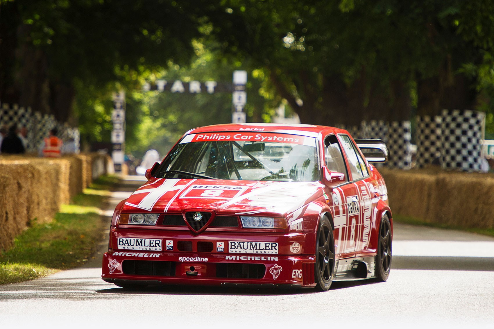 CAR's James Taylor driving the 1993 Alfa Romeo 155 DTM at Goodwood 2017
