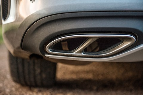 Fake exhaust trim finishers hide the real pipe count on our Mercedes C43