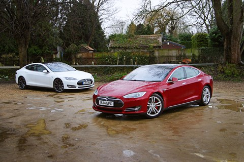 Our Tesla Model S 85D (white car) and the 100,000-mile Tesla owned by Chargemaster (red car)