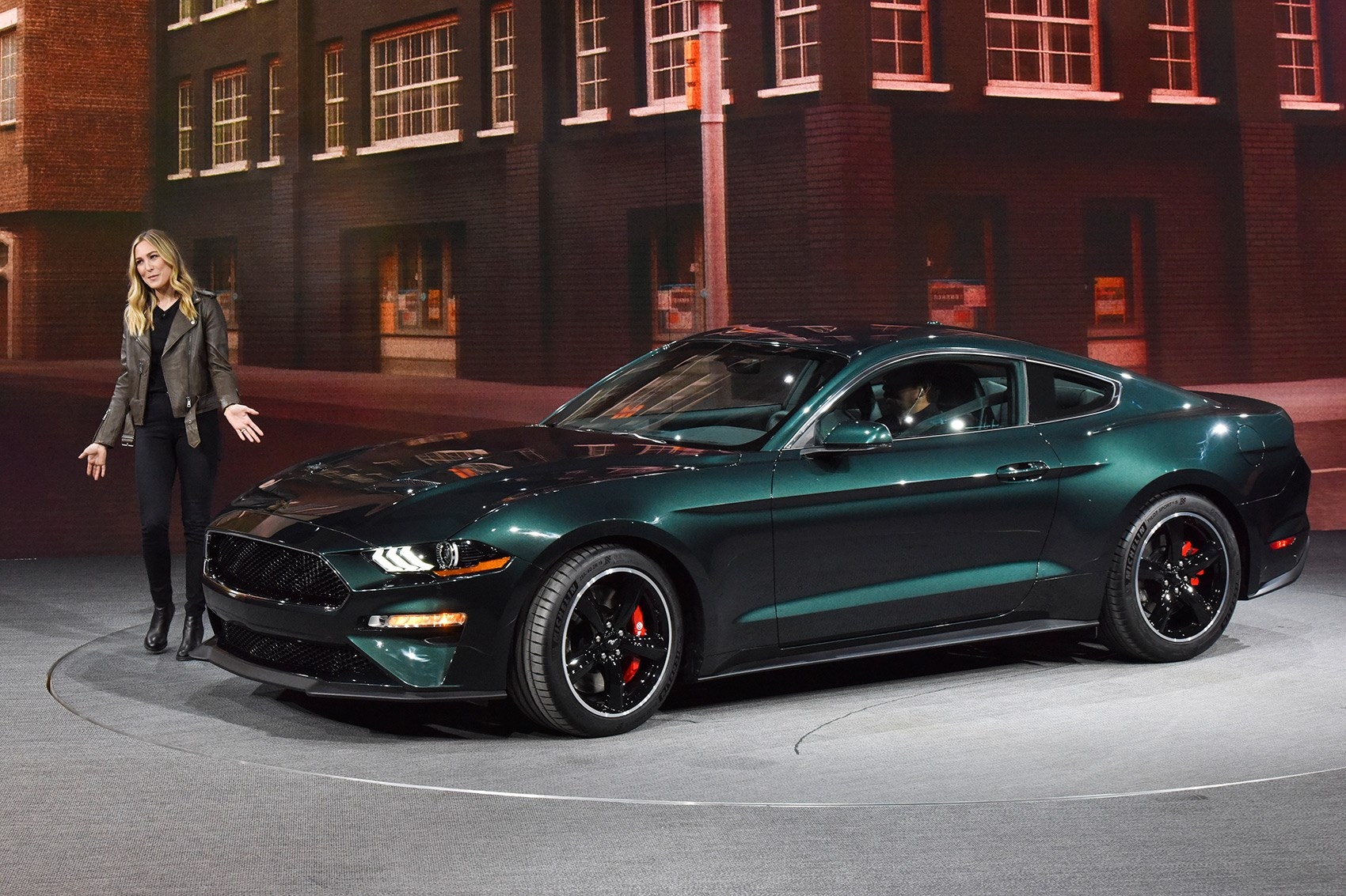 Grand daughter of bullitt actor steve unveils the new 2019 ford mustang bullitt in detroit