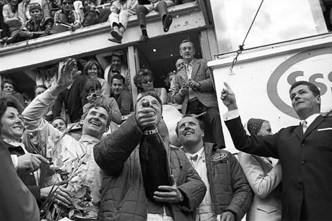 Dan Gurney, A J Foyt, Mike Parkes spray champagne at the 24 Hours of Le Mans, Le Mans, 11 June 1967 (Getty)