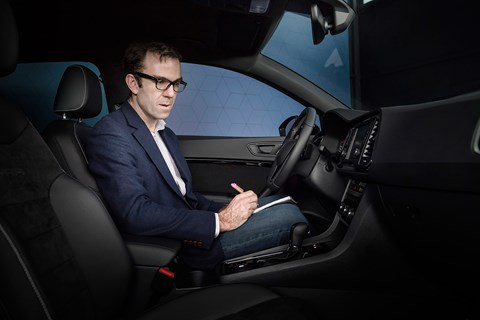 Author Tim Pollard tries out the interior of the Cupra Ateca